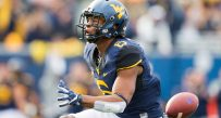 West Virginia's Daikiel Shorts celebrates a 36-yard first-half catch against TCU.