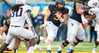 West Virginia Mountaineers quarterback Skyler Howard (3) runs the ball during the second quarter against the TCU Horned Frogs at Milan Puskar Stadium.