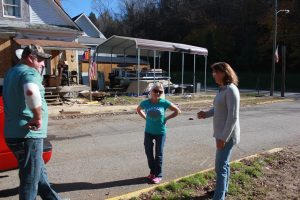 Susan Jack, right, talks with Tina and Tommy Myers, who also lost their home in the flood. They were bringing her a bedframe. She was giving them advice about heating their home this winter as it is renovated.