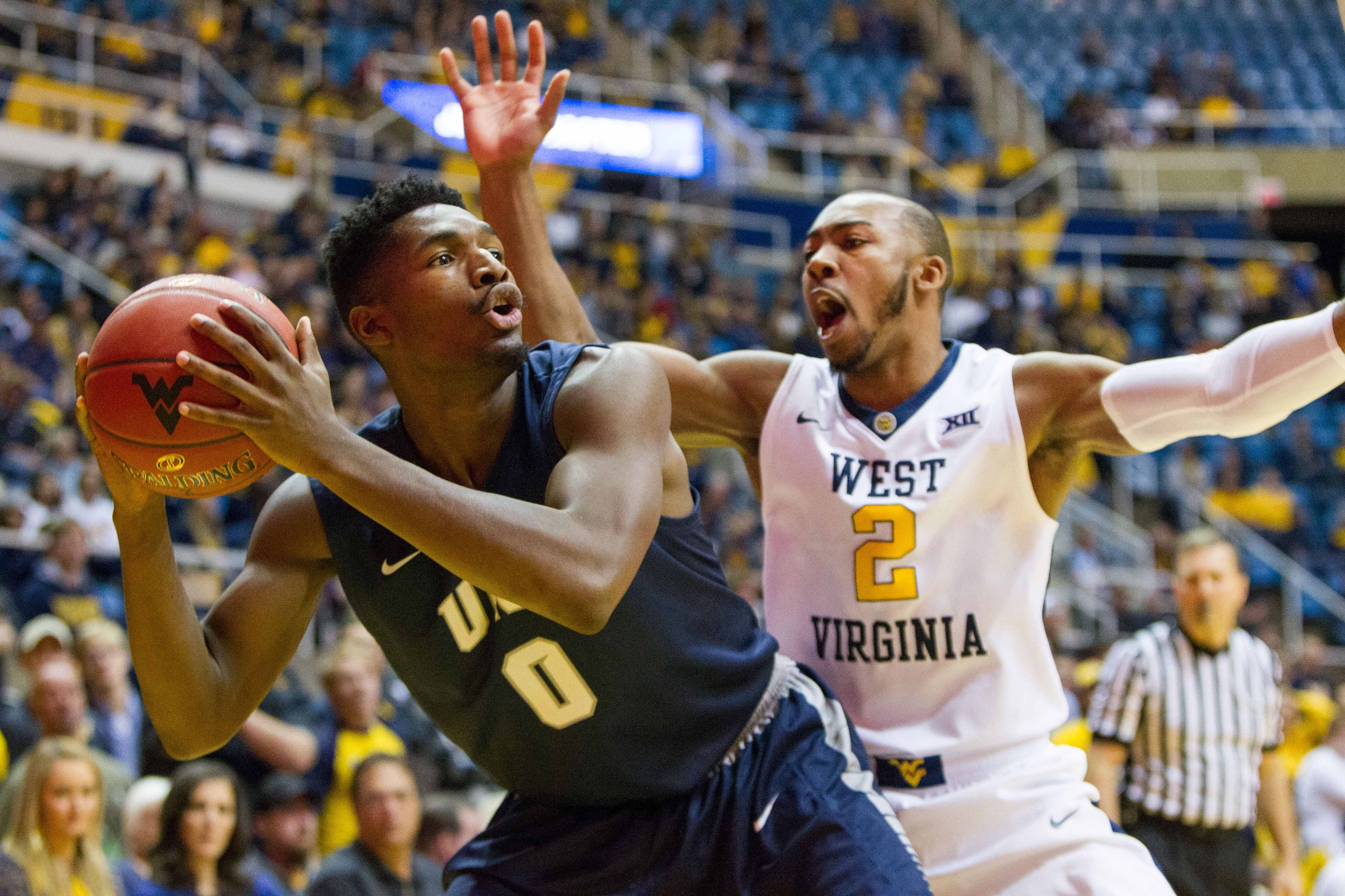 West Virginia's Carter declares for draft, won't hire agent