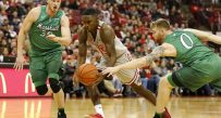 Ohio State Buckeyes guard Kam Williams (15) is defended by Marshall Thundering Herd guard Austin Loop (35) and forward Christian Thieneman (0) during the first half at Value City Arena.