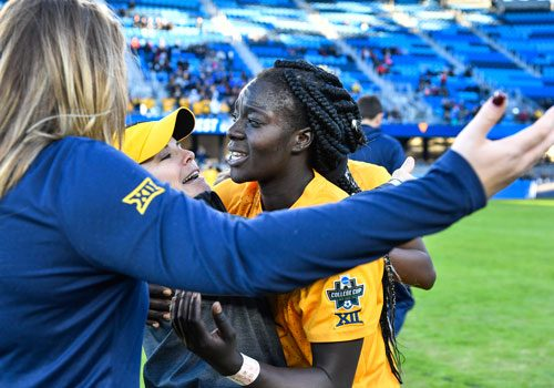 Michaela Abam celebrates with coach Nikki Izzo-Brown following WVU's 1-0 victory over North Carolina in the College Cup semifinal in San Jose, Calif.