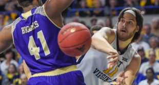 Nathan Adrian makes a pass against Western Carolina during West Virginia's 90-37 victory on Wednesday.