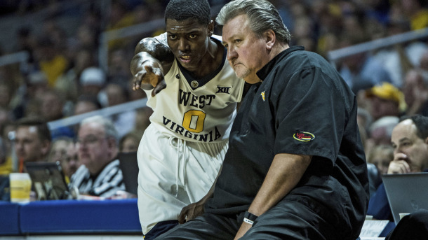 West Virginia's Teyvon Myers (0) talks with head coach Bob Huggins during the second half of an NCAA college basketball game against Western Carolina, Wednesday Dec. 7, 2016 in Charleston, W.Va. West Virginia won 90-37. (AP Photo/Tyler Evert)