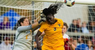 USC Trojans goalkeeper Sammy Jo Prudhomme (1) punches away the ball against West Virginia Mountaineers forward Michaela Abam (5) during the first half in the women's college cup NCAA national championship game at Avaya Stadium.