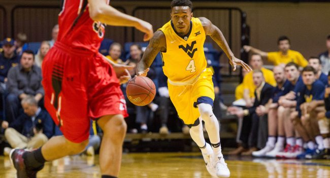 West Virginia Mountaineers guard Daxter Miles Jr. (4) dribbles up the floor during the first half against the Virginia Military Keydets at WVU Coliseum.