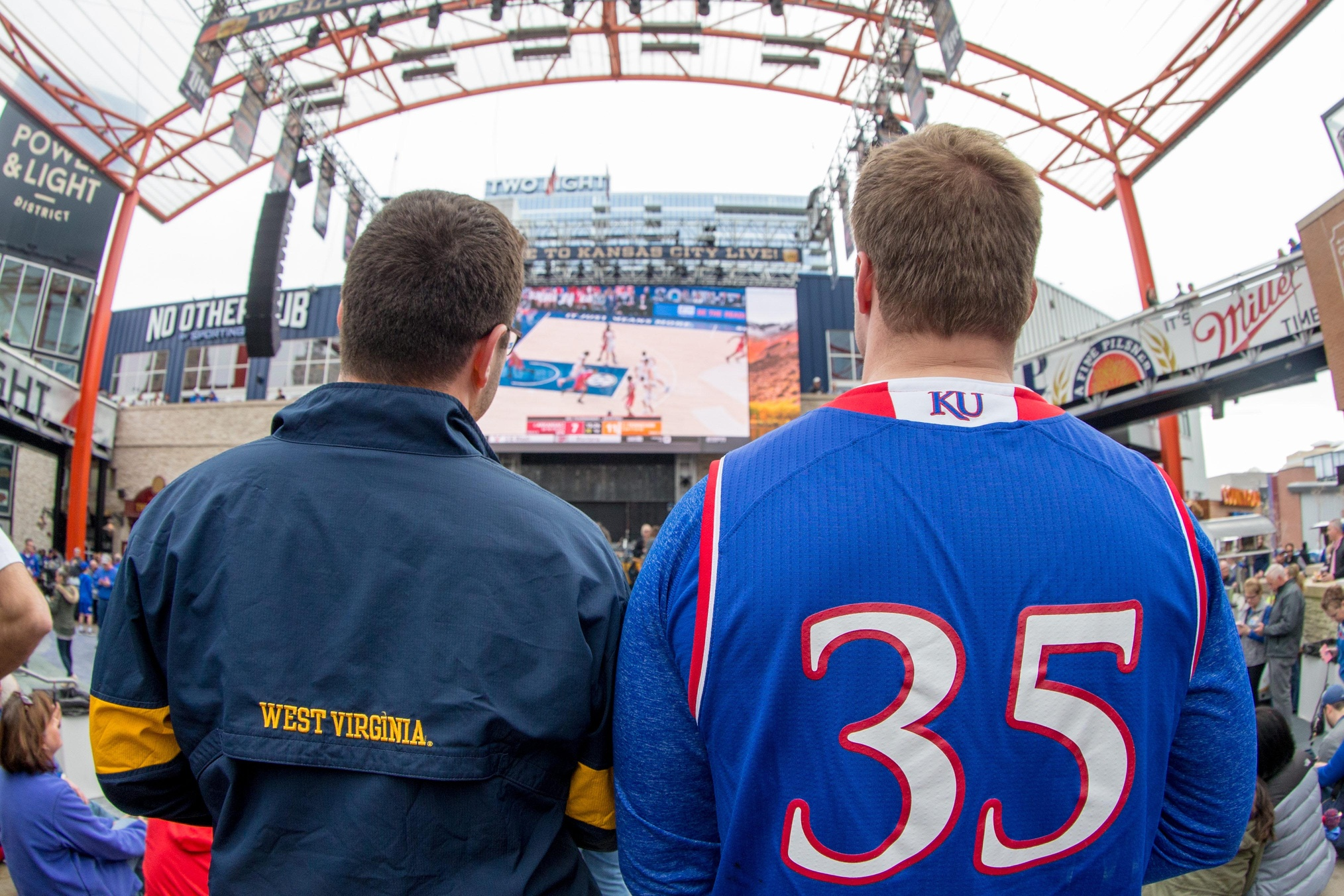 WVMetroNews - Basketball fans watch tournament games on the
