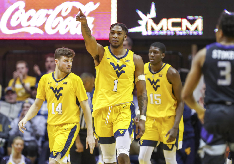 Wade returns, Wildcats win 65-51 over West Virginia