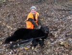 Callen Massey, age 8, of Roanoke, W.Va. with a bear he killed hunting in Pendleton County  W.Va. during the 2020 youth bear season.
