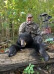 Timothy Browning of Whitman, W.Va. with a bear killed while bow hunting in Logan County, W.Va. in fall 2020.