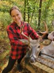 Emmylou McDaniel of Glenville, W.Va. with her first crossbow kill. The buck was killed in Gilmer County, W.Va.