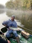 Michael Fitzwater of Arnoldsburg, W.Va. shows off a 38 inch muskie caught from the Little Kanawha River