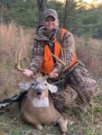 Deborah Wellman of Mount Gay, W.Va. with an 8 point buck killed in the 2020 rifle season in Boone County.