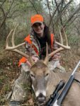 Jennifer Hatfield of Pinsfork, Kentucky shows off a monster buck she killed in Pike County, Ky. during the 2020 rifle season.
