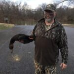 Steven Ratz of Wilkinson, W.Va. with a black duck killed while hunting on the Ohio River near Parkersburg, W.Va.