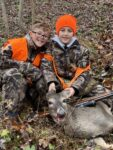 Jager Cole Ross, age 8, pictured here with his twin brother Paxson Jordon Ross and his first deer.  Killed in in the 2020 season with a .270 rifle.