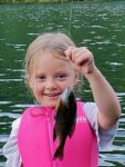 Lillyann Runyon, age 4, with a bluegill she caught from the lake at Grant's Branch Park near here home in Pikeville, Kentucky