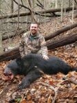 Ryan Jeffrey of Clendenin, W.Va. poses with his first black bear, killed on a hunt in Nicholas County, W.Va.