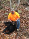 Samuel Marcum of Chapmanville, W.Va. with his first bear killed after a long chase with hounds.