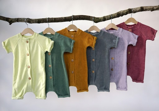 Boxx kids rompers hanging on branch