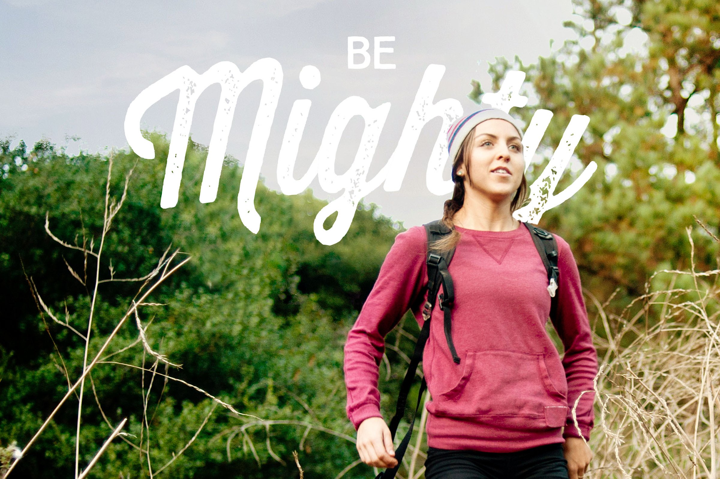 woman hiking with 'be mighty' text in corner of image