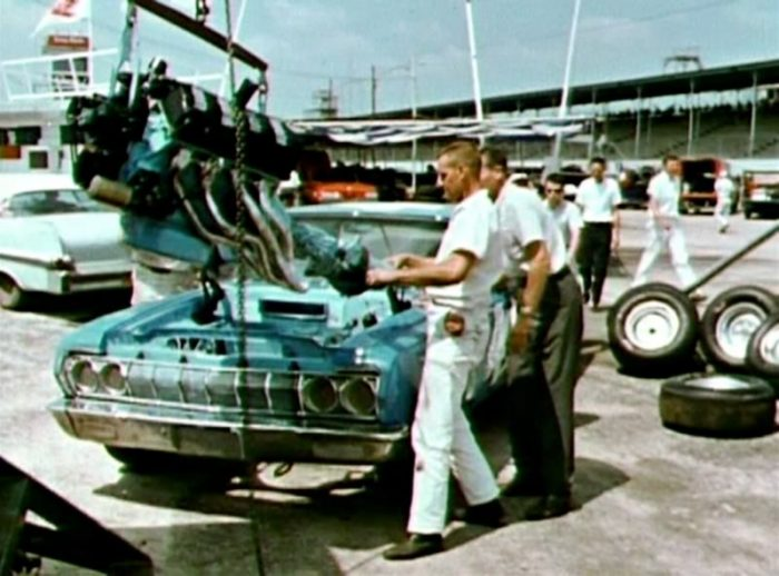 426 Hemi engine being dropped into Ricard Petty's 1964 NASCAR Plymouth
