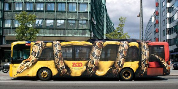 A Bus With A Snake Wrap