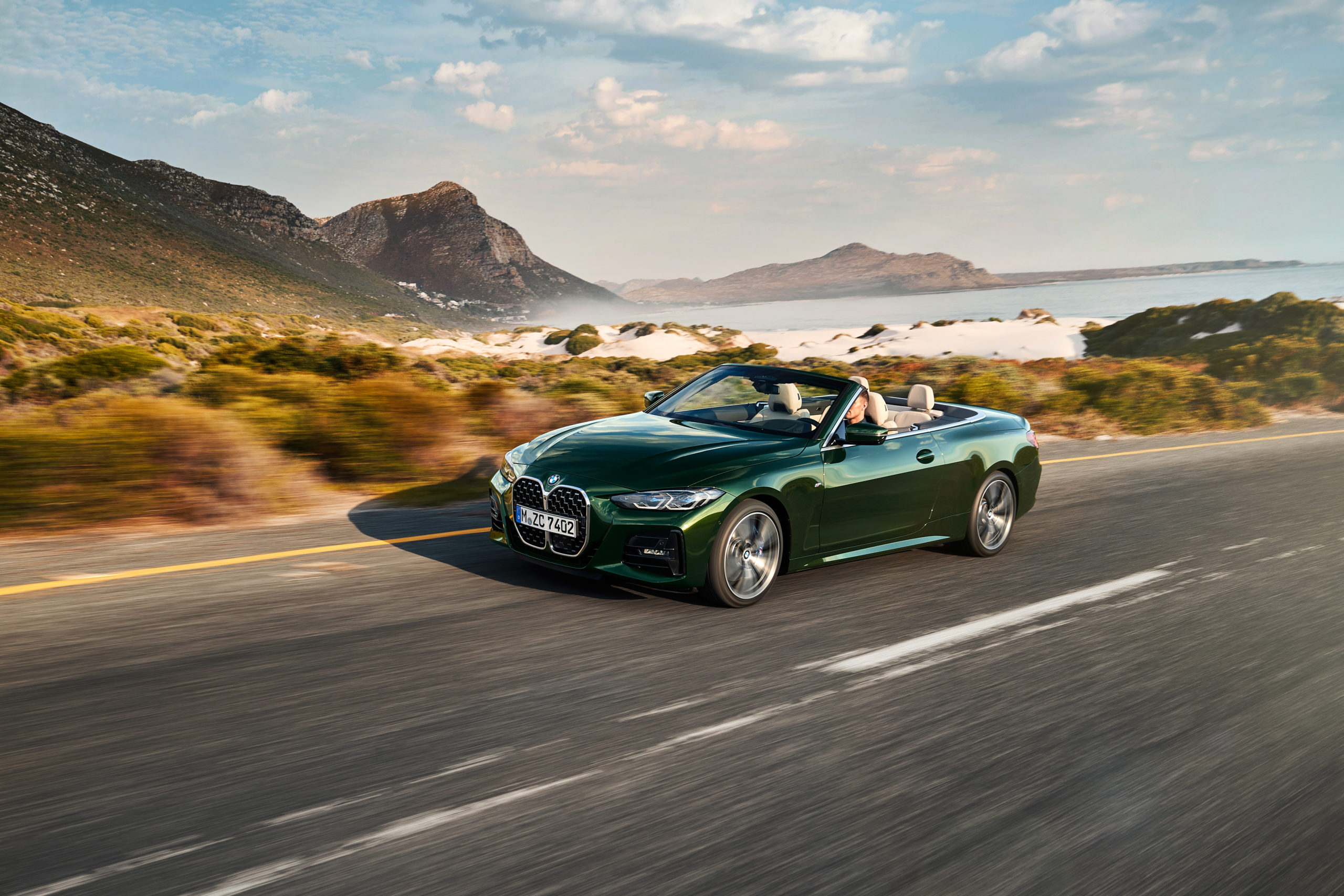 Green 2021 BMW 4 Series Convertible on road