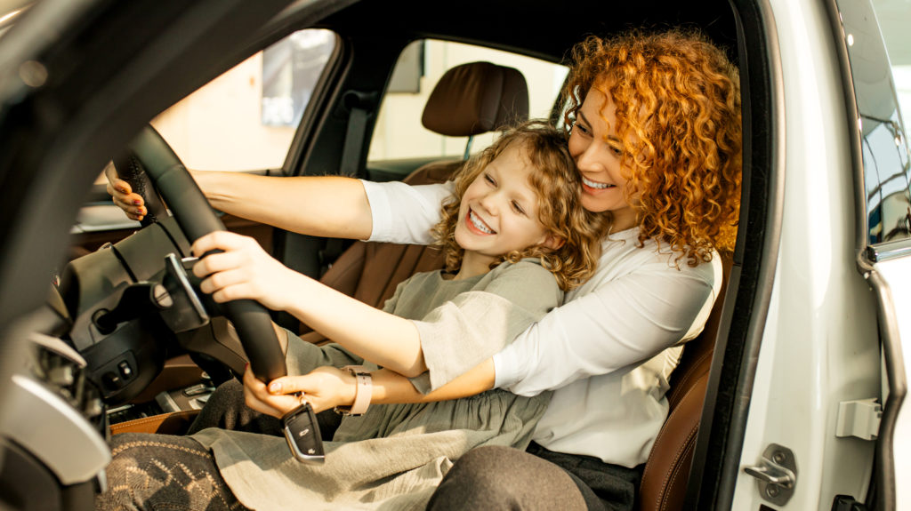 automotive gifts for mom - mom and daughter in car
