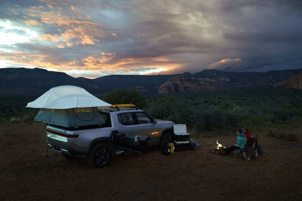 Off-Road Electric Rivian R1T Truck camp setup at sunset in Sedona Arizona