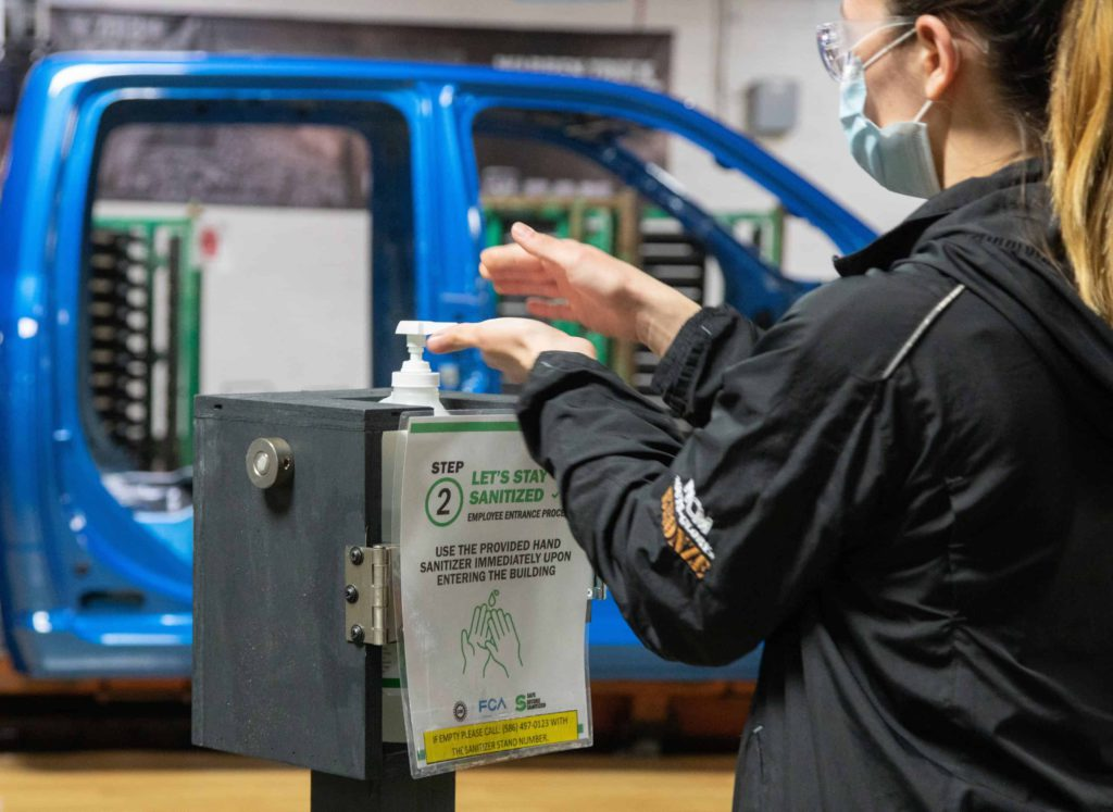 COVID car sales hand sanitizer station in warren truck assembly plant