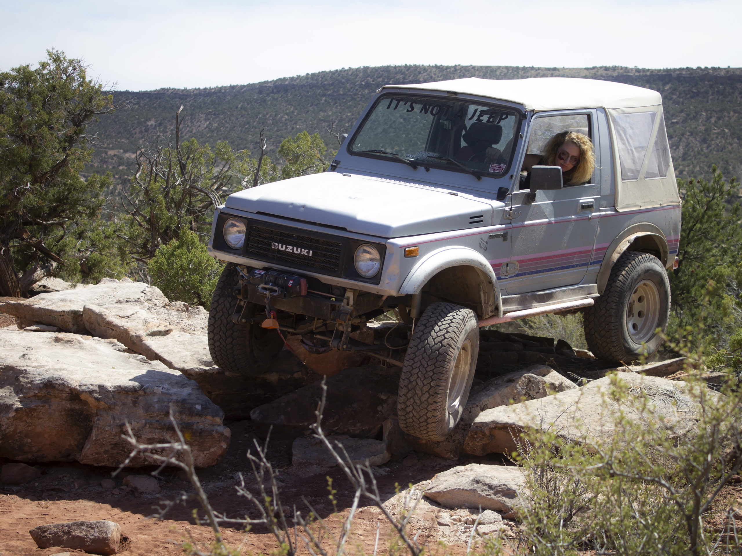 Suzuki Samurai, Amber Turner, custom rock sliders