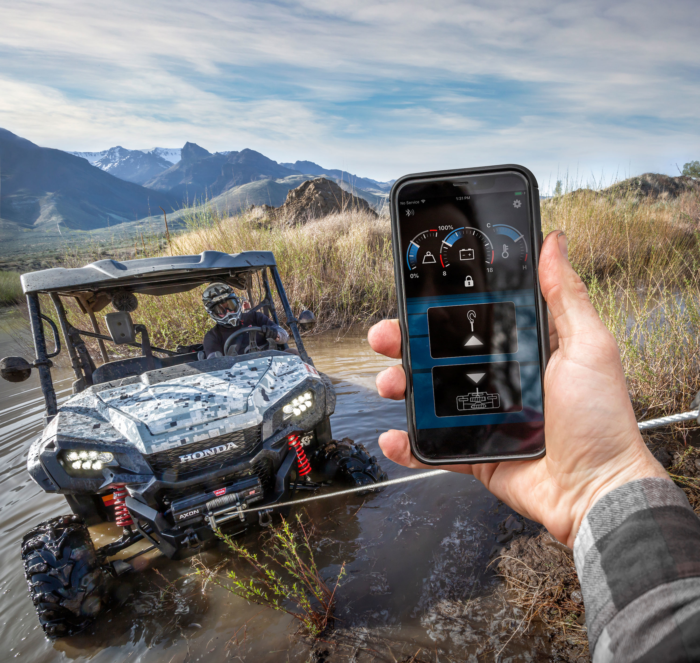 WARN HUB Receiver & App is a wireless winch remote shown here with WARN AXON.