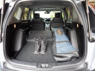 snowboard and boots inside 2021 Honda CR-V AWD