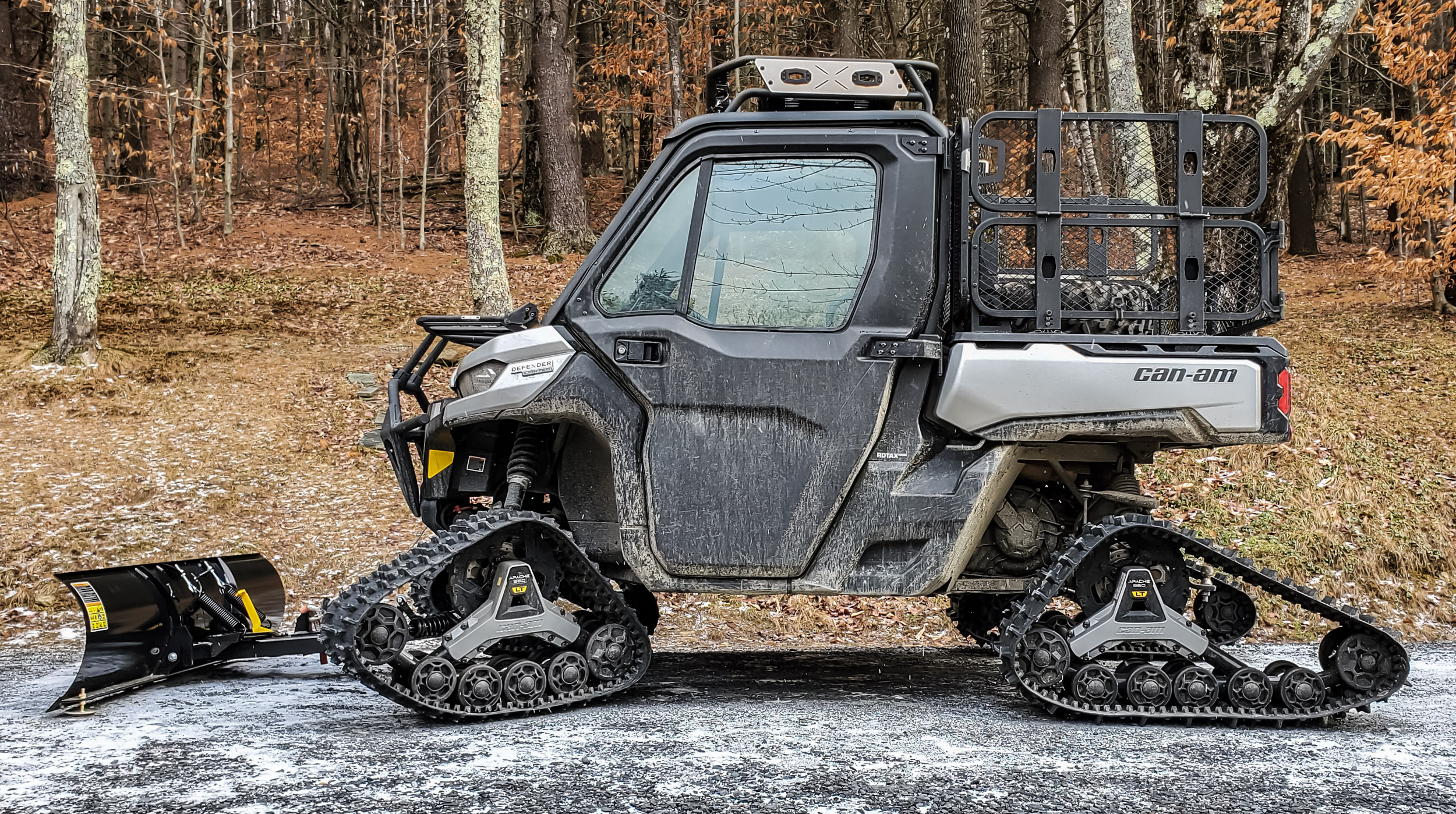 2021 Can-Am Defender Limited on tracks with plow