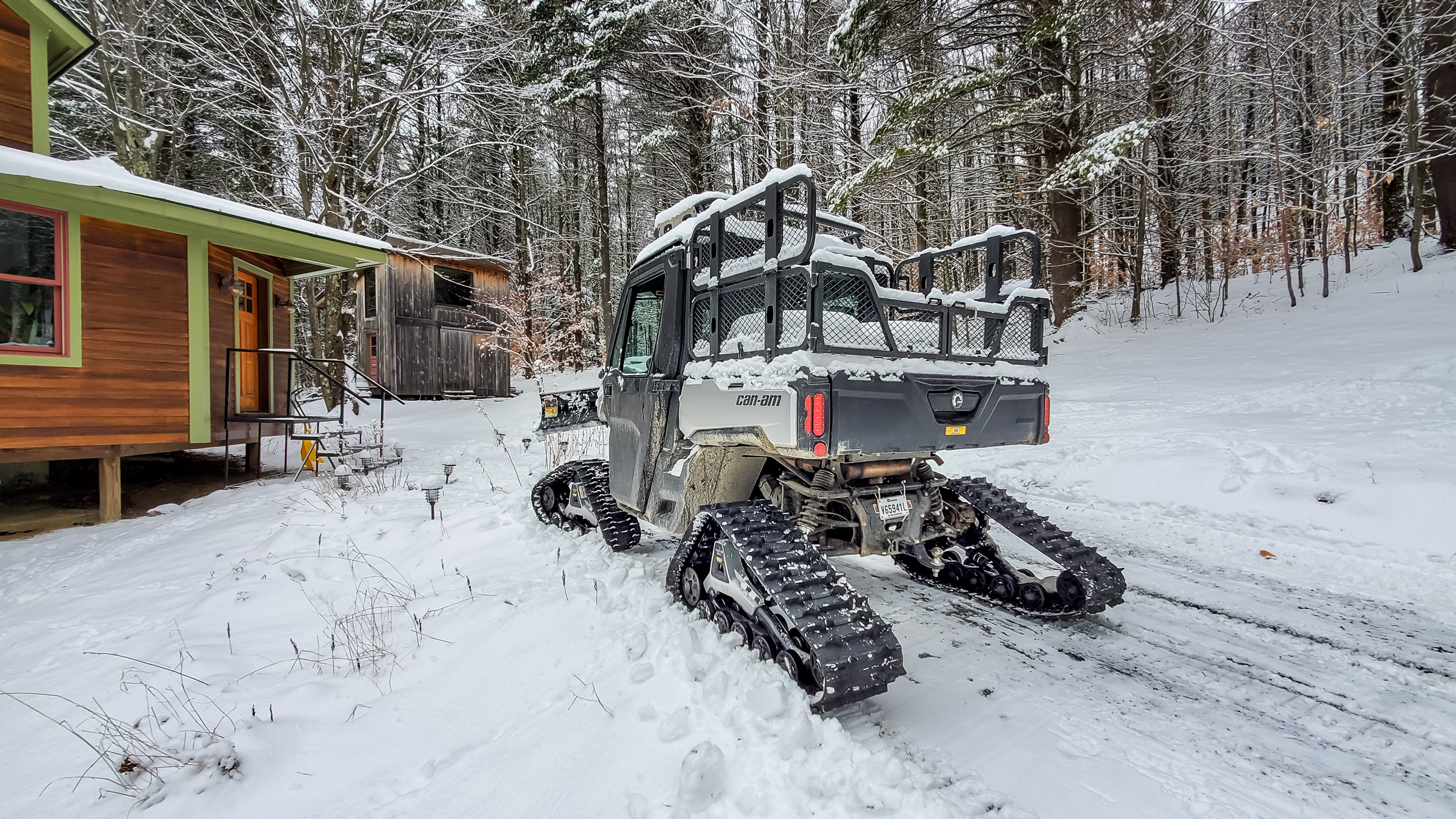 2021 Can-Am Defender Limited on tracks with plow rear