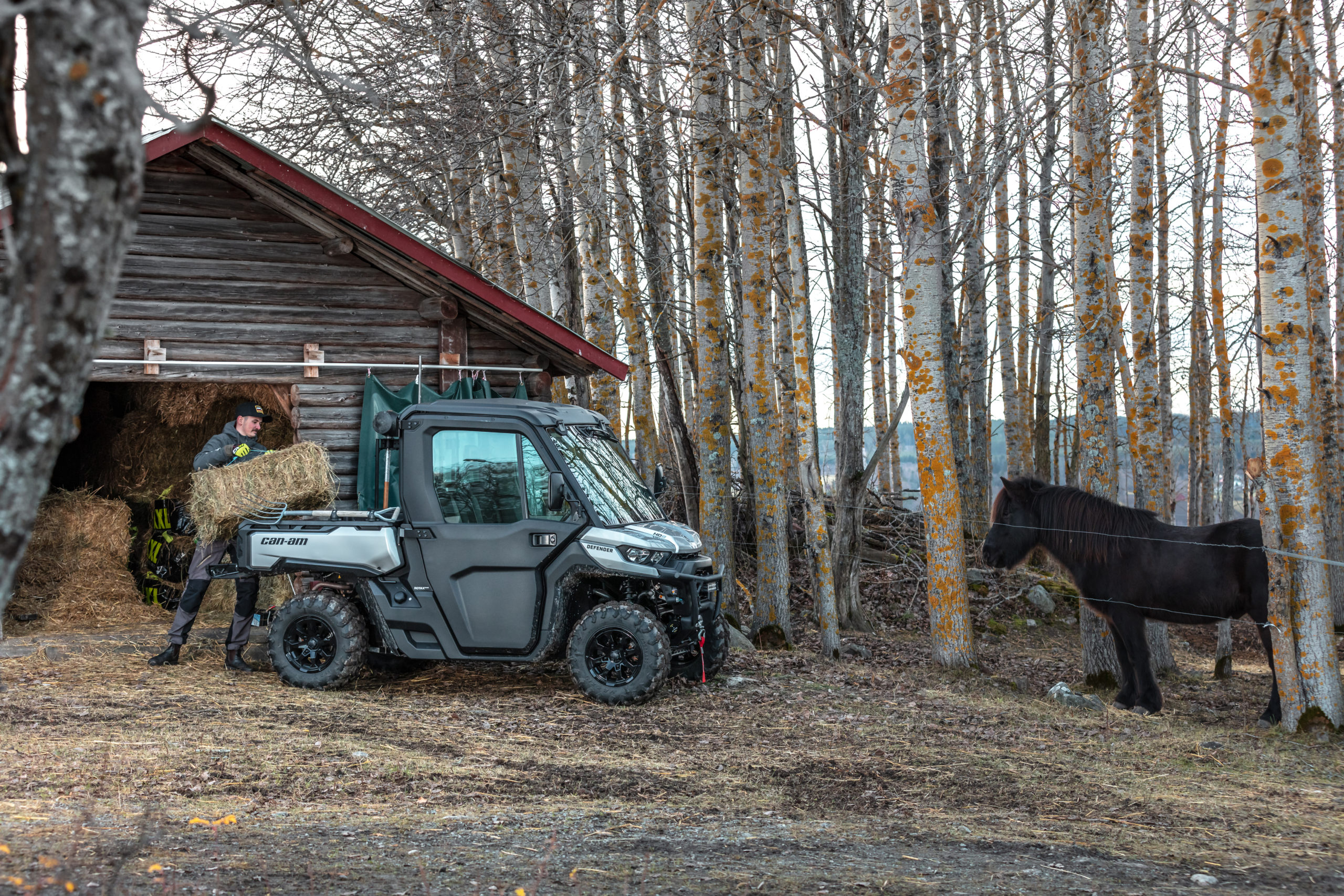 2021 Can-Am Defender carrying hay