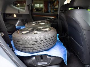 tires and wheels loaded into honda cr-v