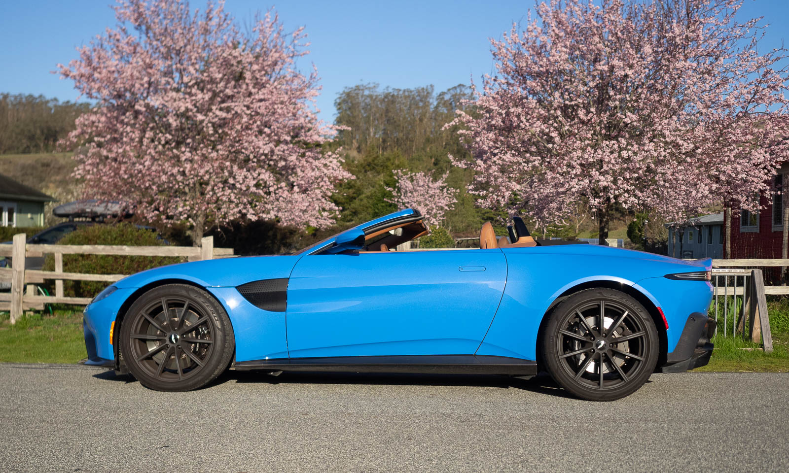 2021 Aston Martin Vantage Roadster convertible top down profile in blue