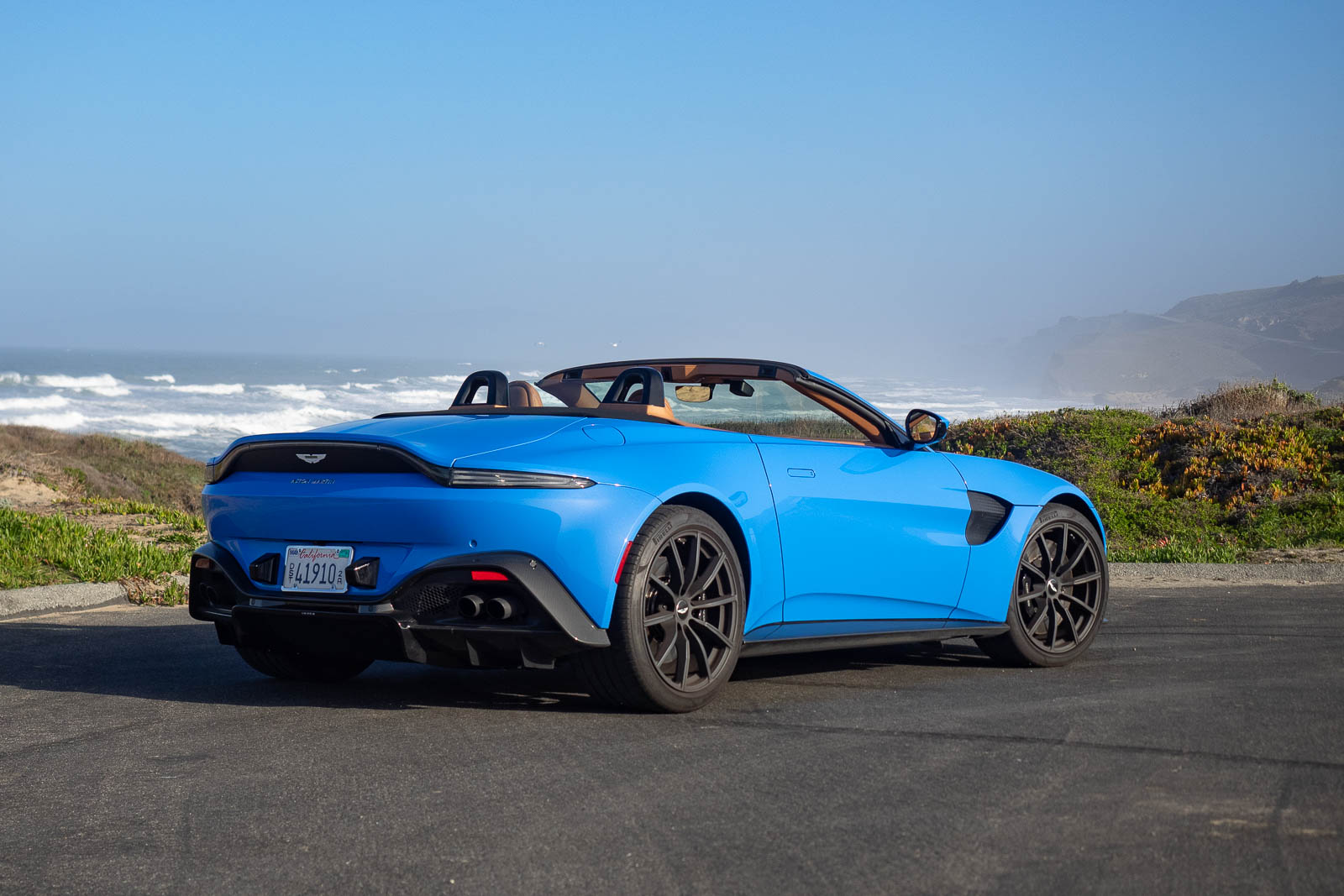 2021 Aston Martin Vantage Roadster rear 3/4 view in ceramic blue at coast