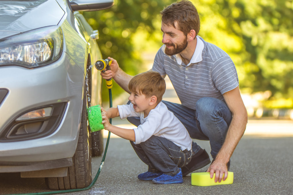Car Gifts For Dad - father and son wash a car