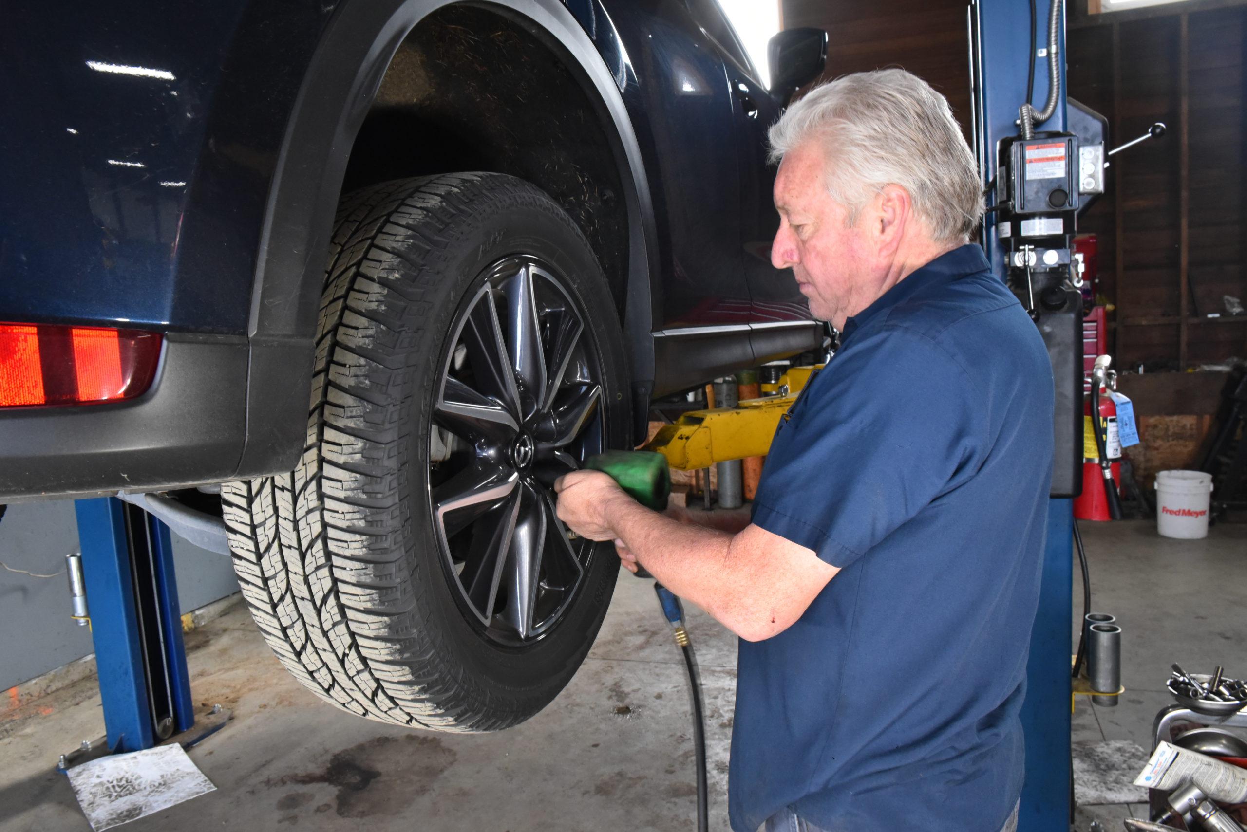 Mazda CX-5 on lift with mechanic