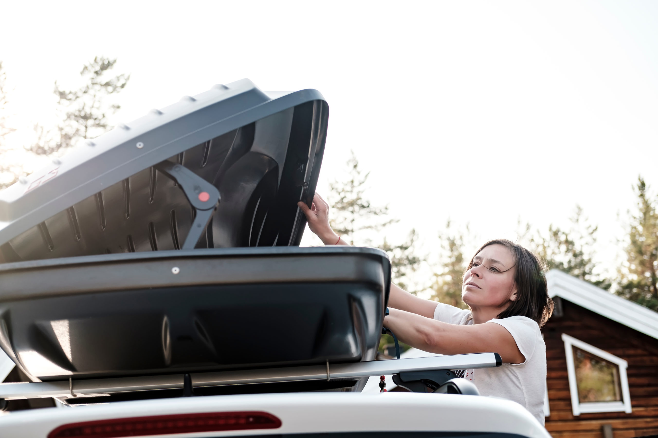 women opening cargo box