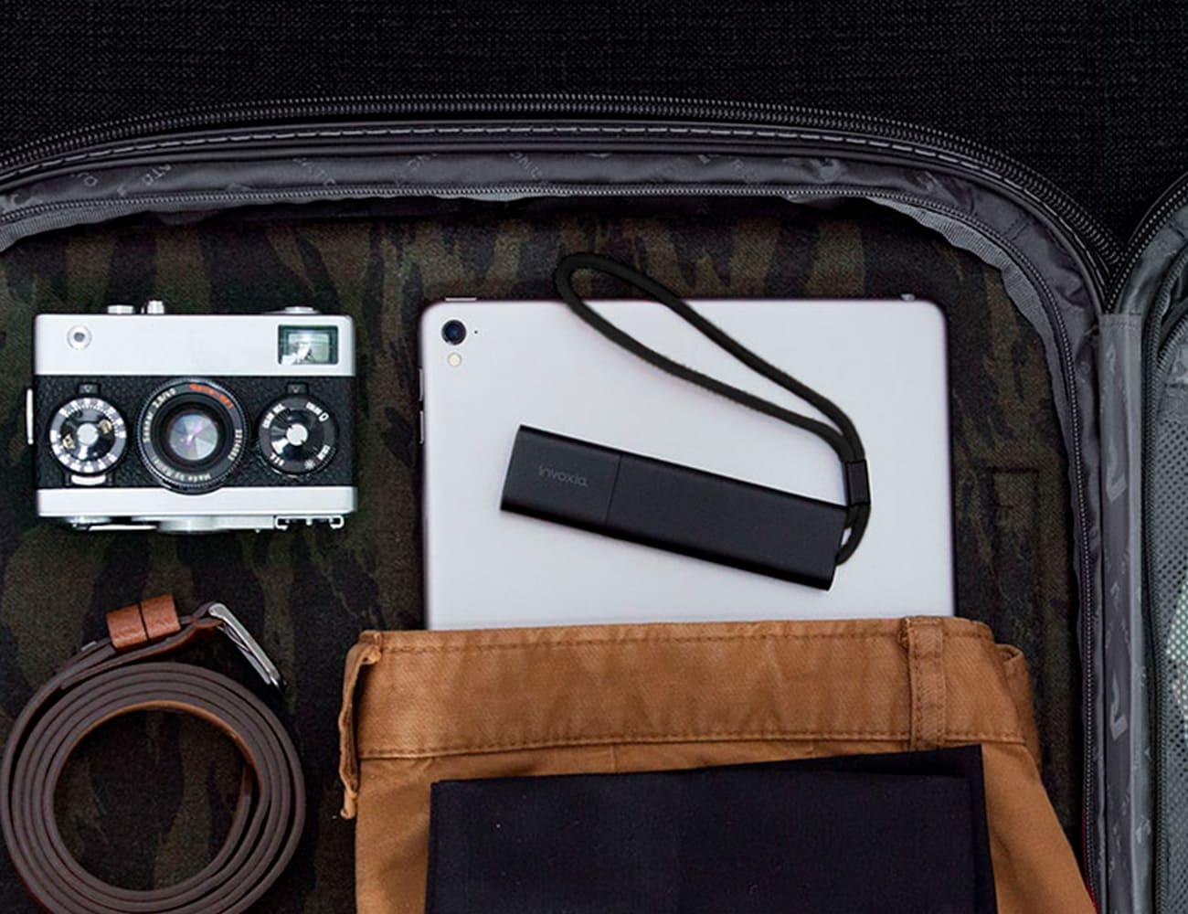 Invoxia GPS tracker in bag