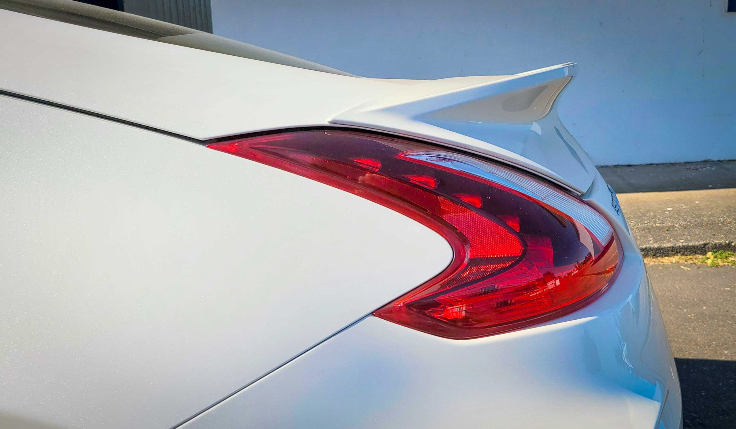 The white Nissan 370Z Nismo's sleek rear taillights.