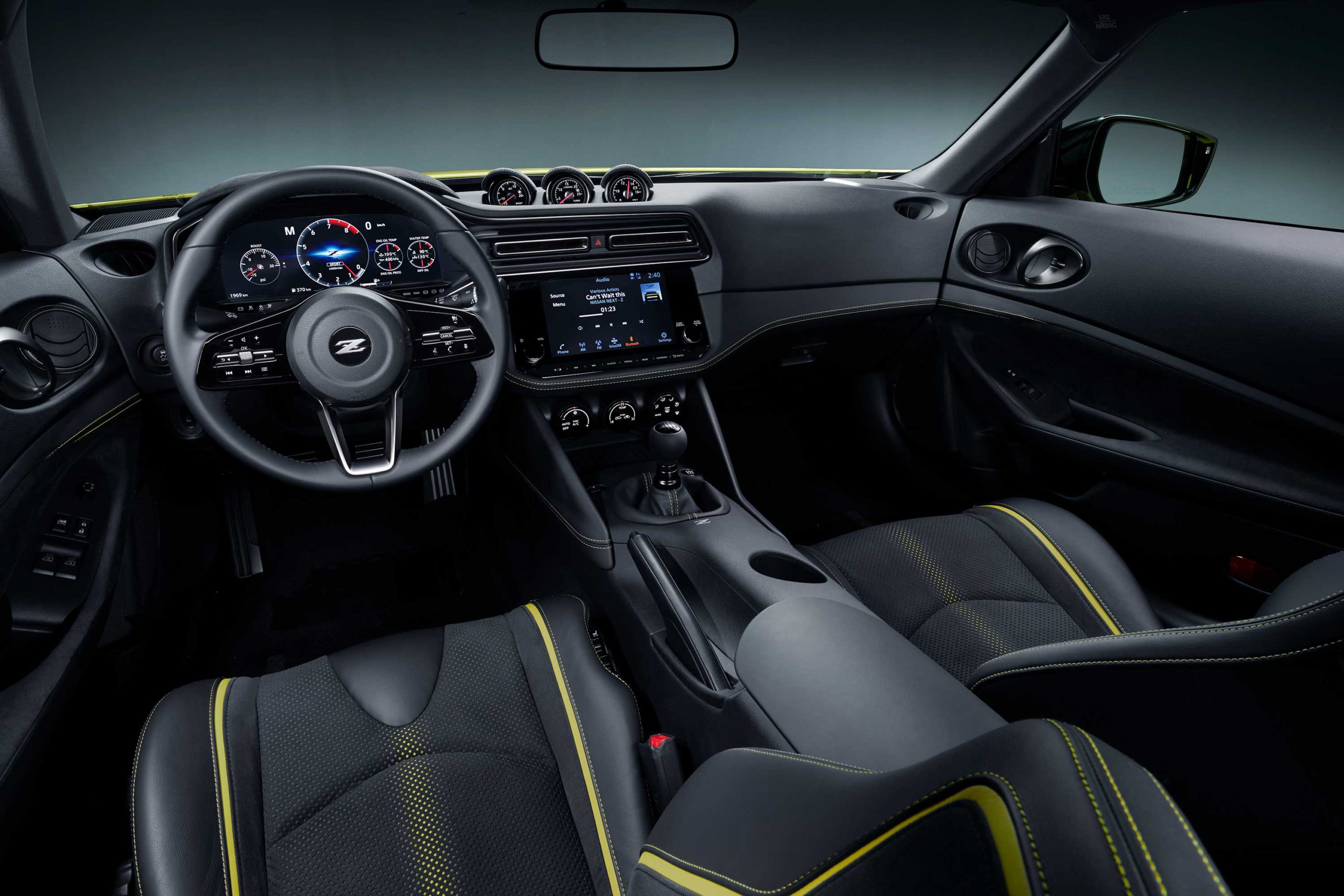 The Nissan 400Z prototype with yellow-accented black interior.