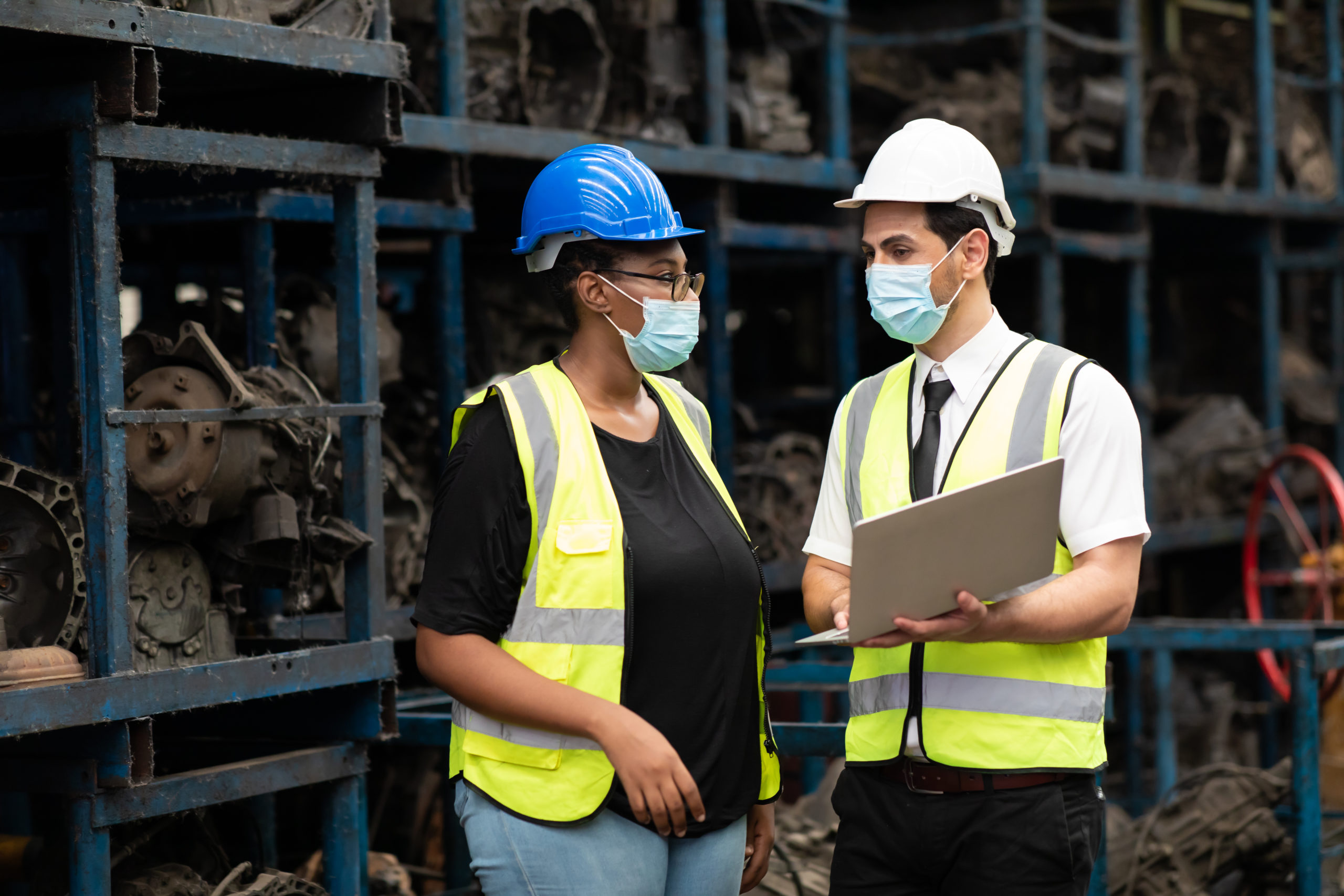 workers wear masks due to Covid-19