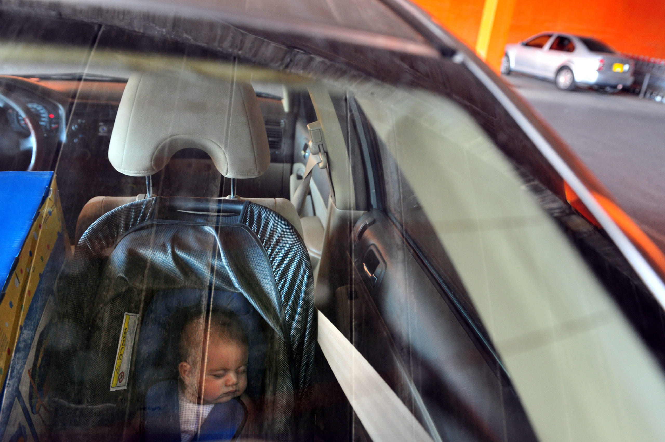 baby in car seat in back of car