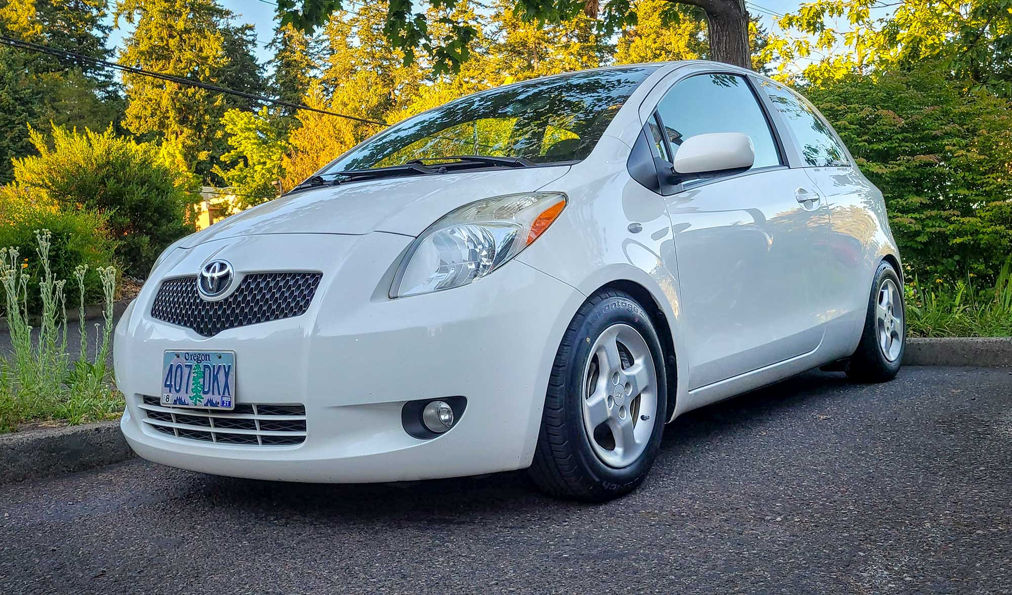 White Toyota Yaris parked with BFGoodrich Advantage Control tires