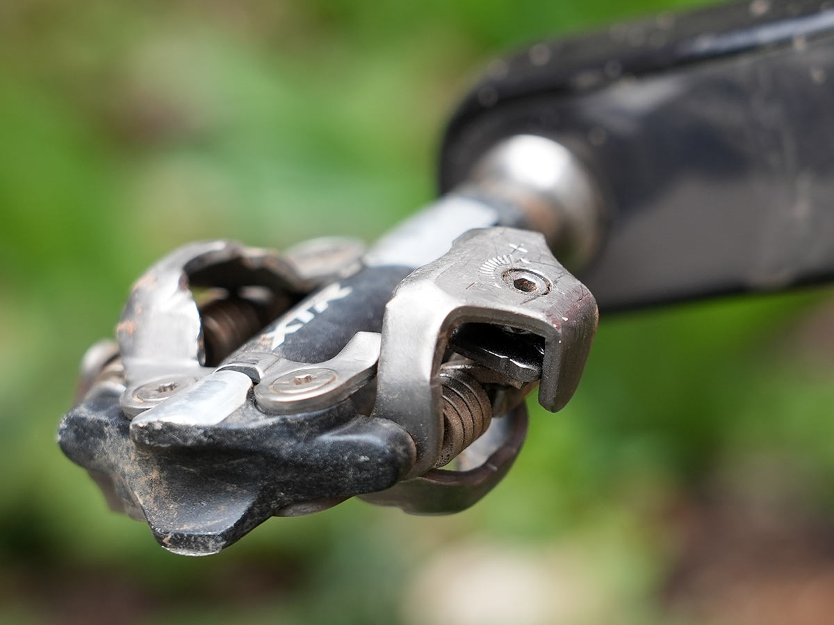 mountain bike pedal retention spring lets you adjust the amount of force required to clip out of the pedal